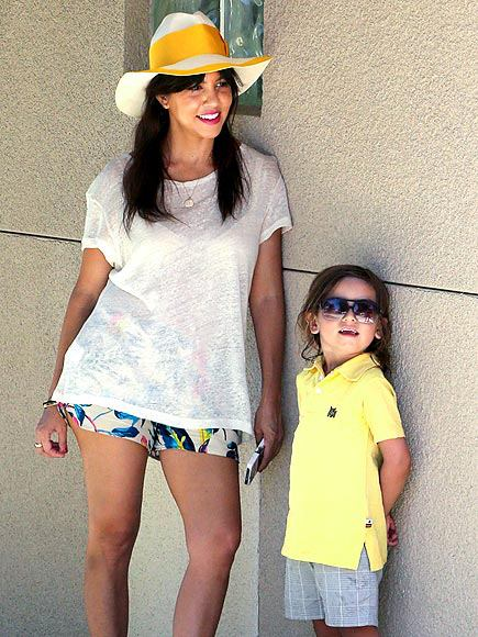 Kourtney Kardashian and Mason chill out while donning summery attire. Wonder if Kim will follow Kourtney's parenting style?