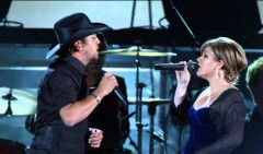 This powerful duet by Kelly Clarkson and Jason Aldean became a hit on both the Pop and Country music charts . . . [Video]