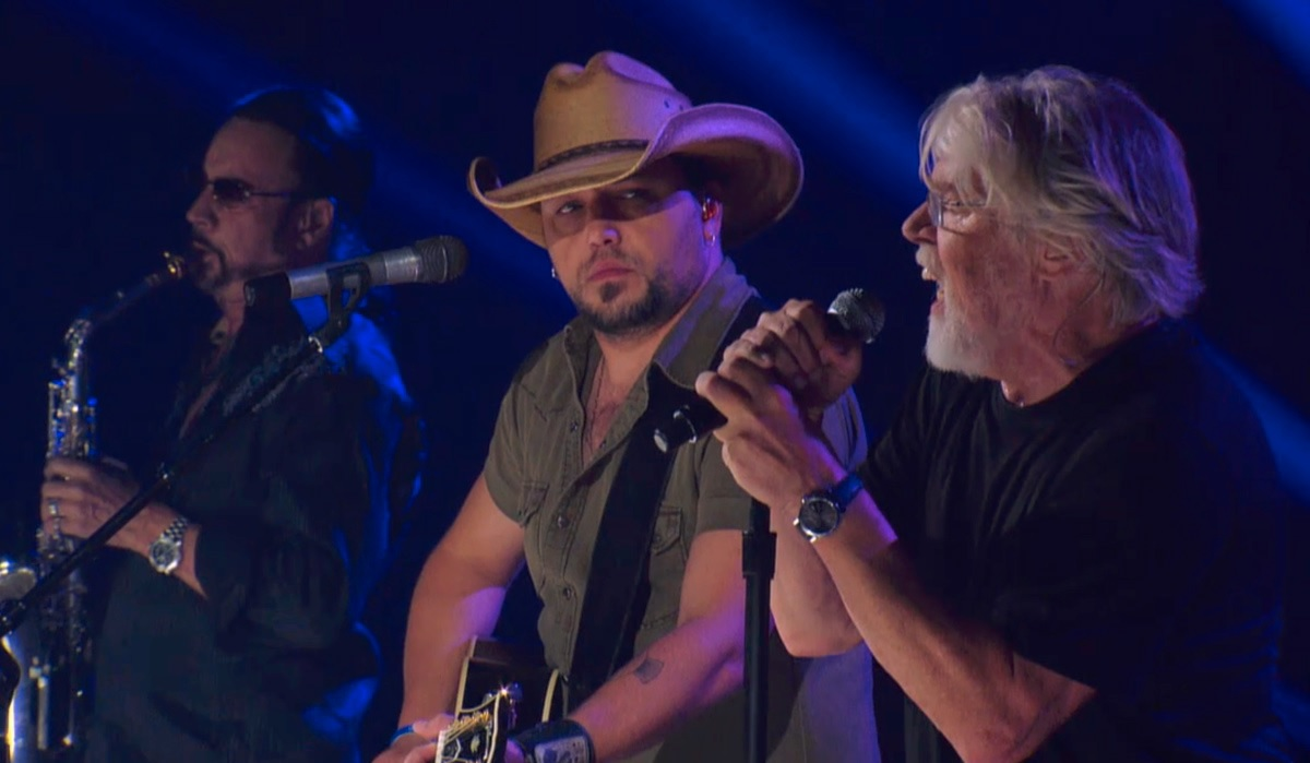 "Jason Aldean and Bob Seger perform ""Turn the Page"" live on stage"