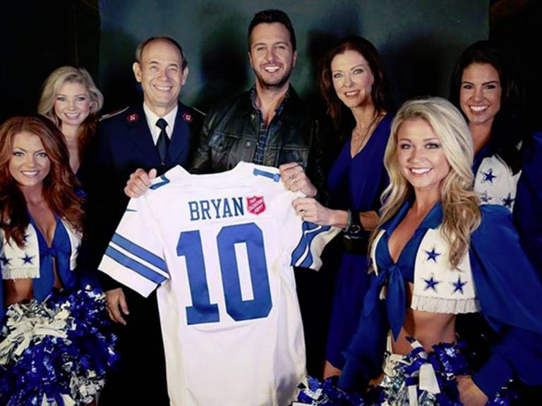 Luke Bryan with the Salvation Army and Dallas Cowboys Cheerleaders