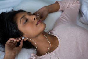 A woman enjoying sounds to help you sleep