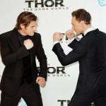 Thor vs. Loki! Chris Hemsworth and Tom Hiddleston play fight at the London opening of their new film. Who would you root for???