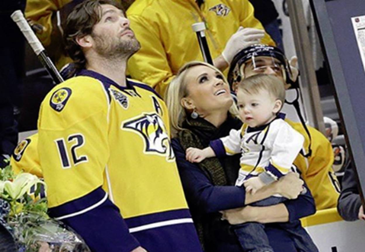 carrie underwood and mike fisher with isaiah